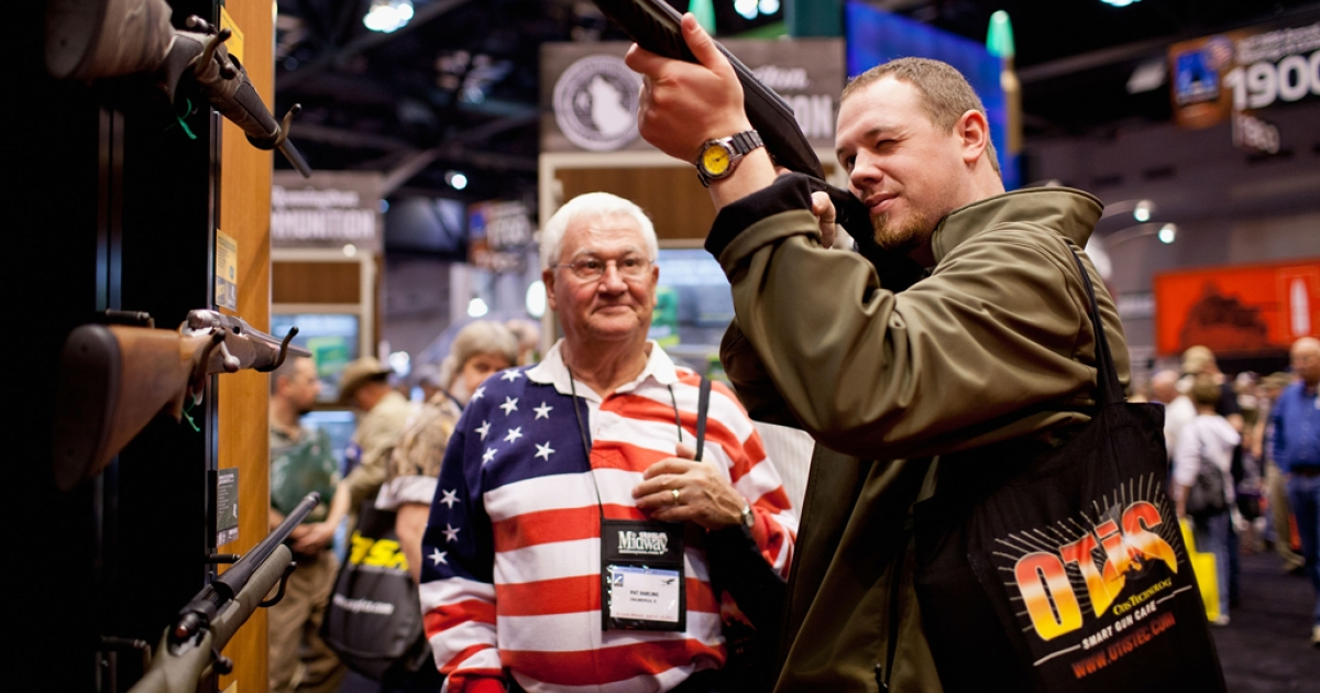 Pat Darling (L) and his nephew, Chip Darling, look at a Remington rifle display during the NRA Annual Meetings and Exhibits at America's Center in St. Louis, Missouri. A new survey by Pew Research Center found increasing support for gun owner rights and gay marriage on April 25, 2012.</p>