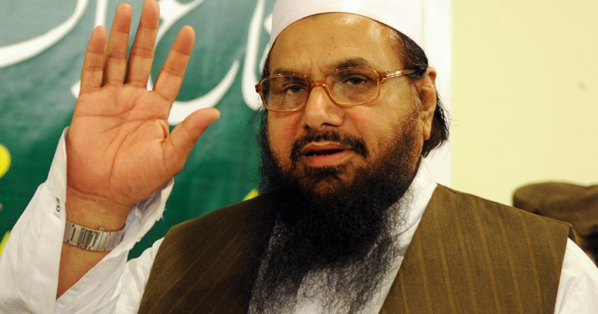 Hafiz Saeed, the founder of Lashkar-e-Taiba, gestures as he leaves after a news conference in Rawalpindi on April 4, 2012. Pakistani Prime Minister Yousaf Raza Gilani said Saeed was an