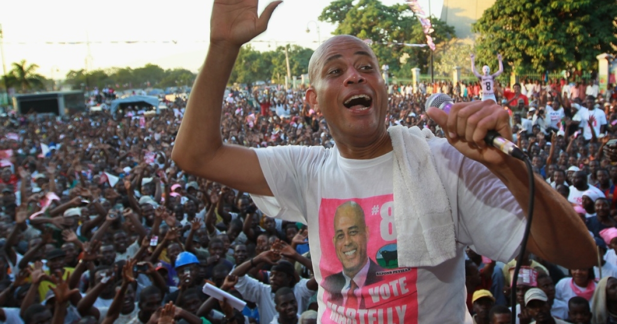 Haitian presidential candidate, Michel Martelly speaks to his supporters during a campaign rally on Nov. 25, 2010, in Port-au-Prince.</p>