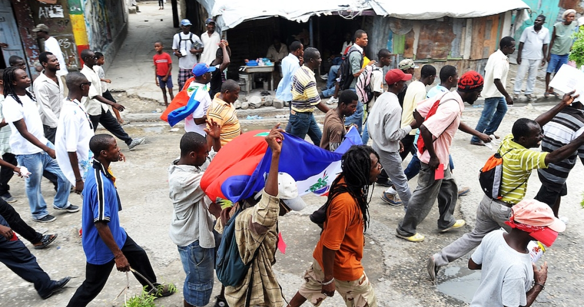 Haitians protest against the government and the cost of living on September 30, 2012 in Port-au-Prince. The next day, a protest to demand better housing opportunities was cancelled because of alleged government intimidation of people living in tent cities.</p>