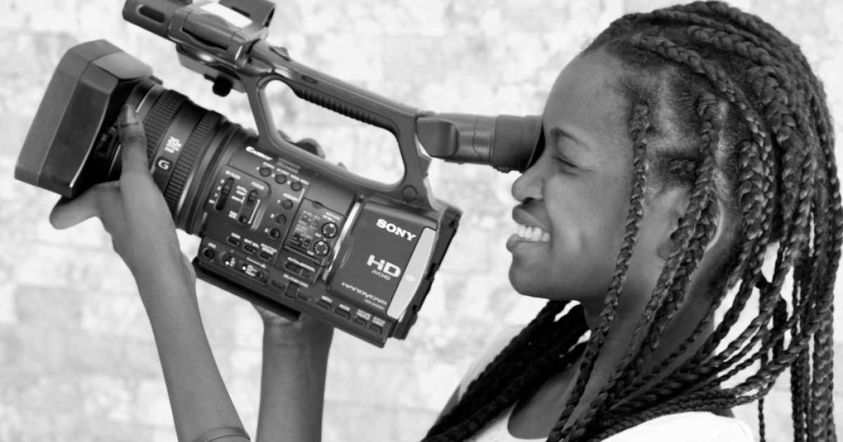 A student shoots video as a part of Haiti Reporters, an initiative to help young journalists learn and get hands-on experience documenting the lives of Haitians.</p>