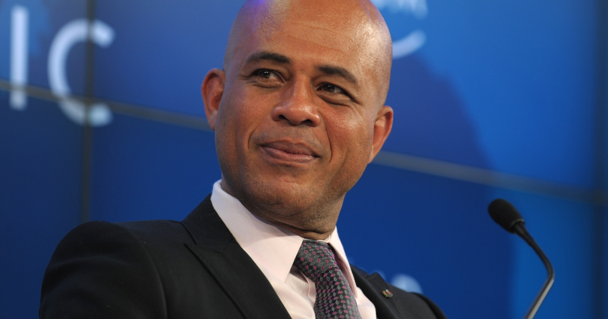 Haitian President Michel Joseph Martelly listens Jan 27 during a session on