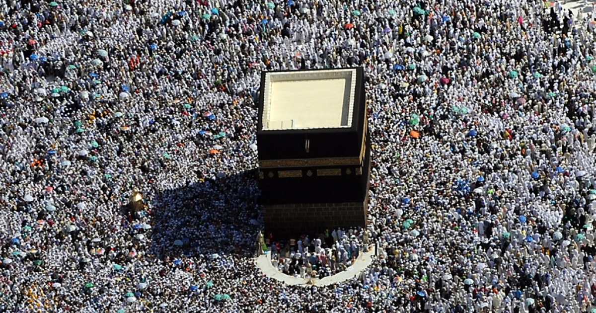 Muslim pilgrims walk around the Kaaba in the Grand Mosque in Mecca during the annual Hajj.</p>