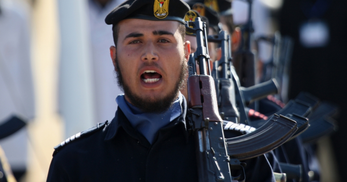 Hamas police officers march in formation during a ceremony in the Gaza Strip. The Hamas leadership outside Gaza may be leaving its headquarters in Damascus, Syria, in a move some say will anger Iran.</p>