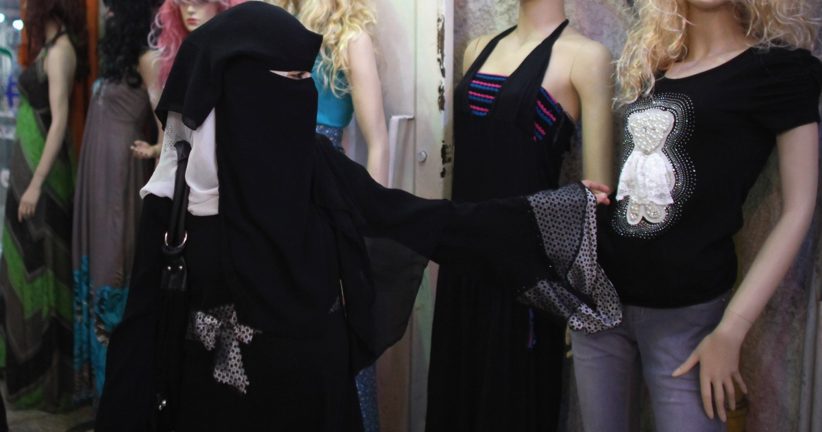 A Palestinian women browse fashionable clothes in a shopping mall in Gaza City, Gaza. Hamas officials appear to be no longer concerned with the appearance of mannequins and other displays in clothing stores.</p>