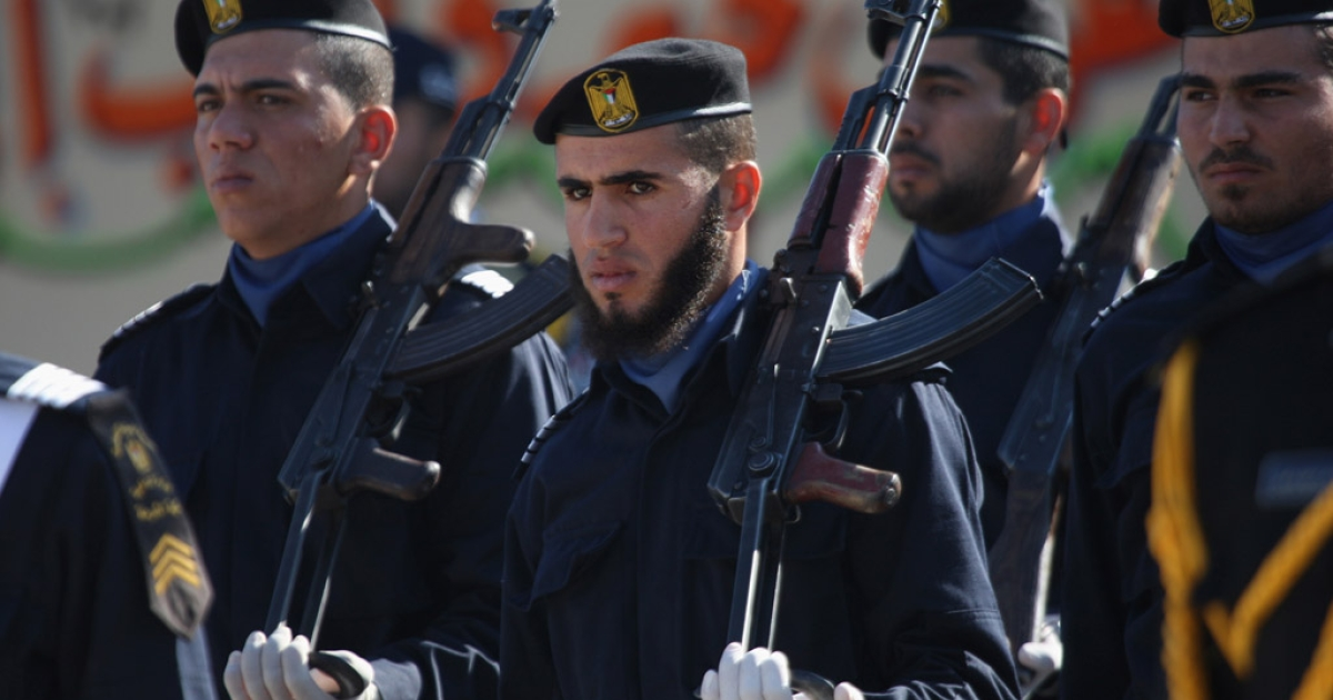 Hamas police officers march in formation in Gaza. Hamas militants may have been behind the stabbing of a prominent Palestinian rights activist.</p>
