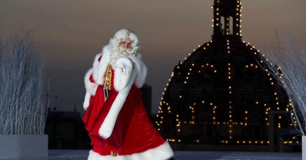 A Santa Claus ice skates atop Harrod's Department Store in London on July 28, 2011.</p>