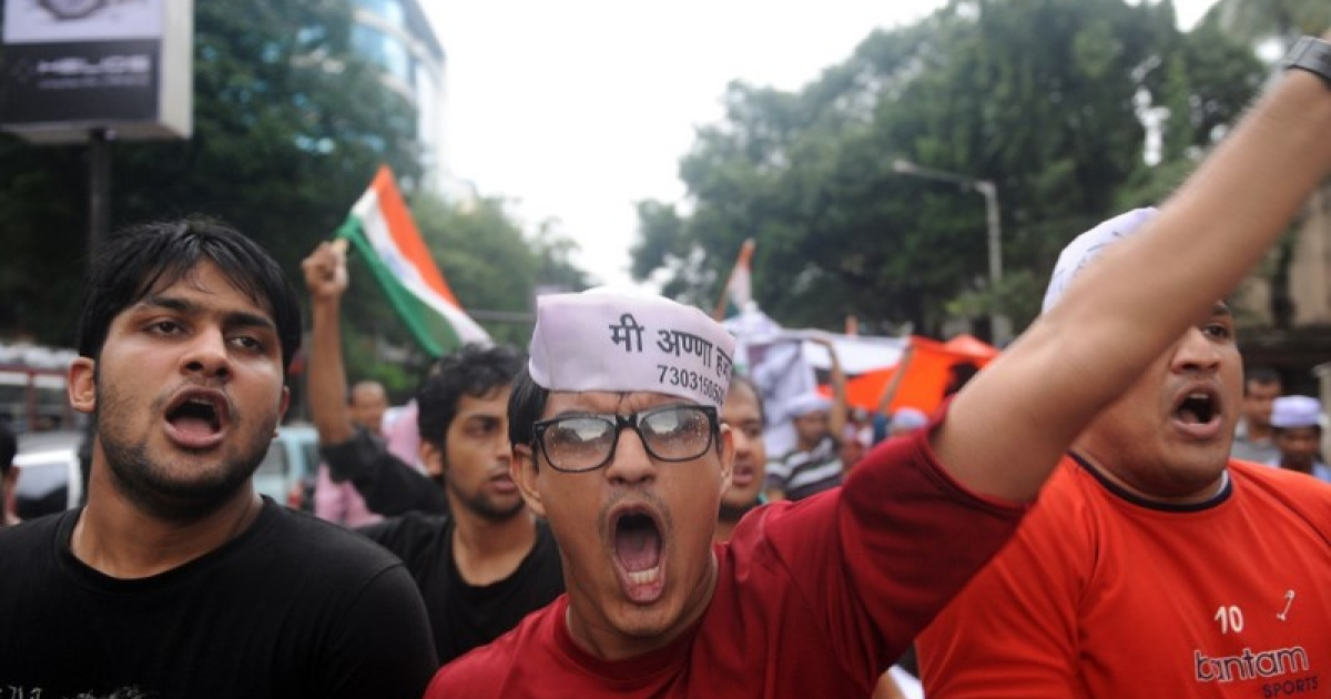 Indian youths shout slogans during a rally in support of social activist Anna Hazare in Mumbai on August 21, 2011. Prime Minister Manmohan Singh's government has been left floundering by a national swell of support for Hazare's campaign, with many Indians saying years of anger at corrupt officials had reached boiling point.</p>