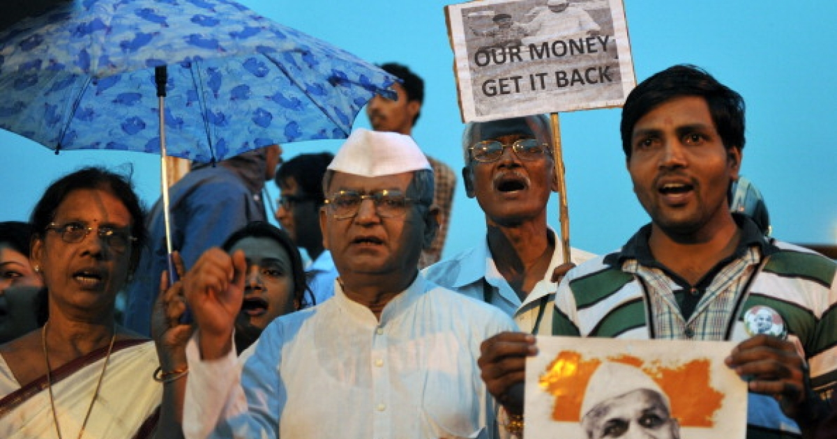 Supporters of Indian social activist Anna Hazare participate in a vigil in Hyderabad on August 24, 2011. Indian Prime Minister Manmohan Singh and political rivals joined forces on Wednesday to appeal to social activist Anna Hazare to end his anti-corruption hunger strike, now in its second week. Hazare's anti-graft drive has brought people onto the streets of cities across the country, calling for an end to the culture of corruption that permeates all levels of Indian society.</p>