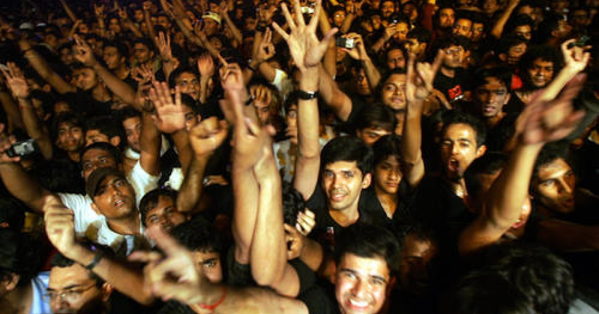 In this picture taken 16 March 2007, Indian fans of British rock group Iron Maiden shout as their heroes perform during a concert in Bangalore.</p>