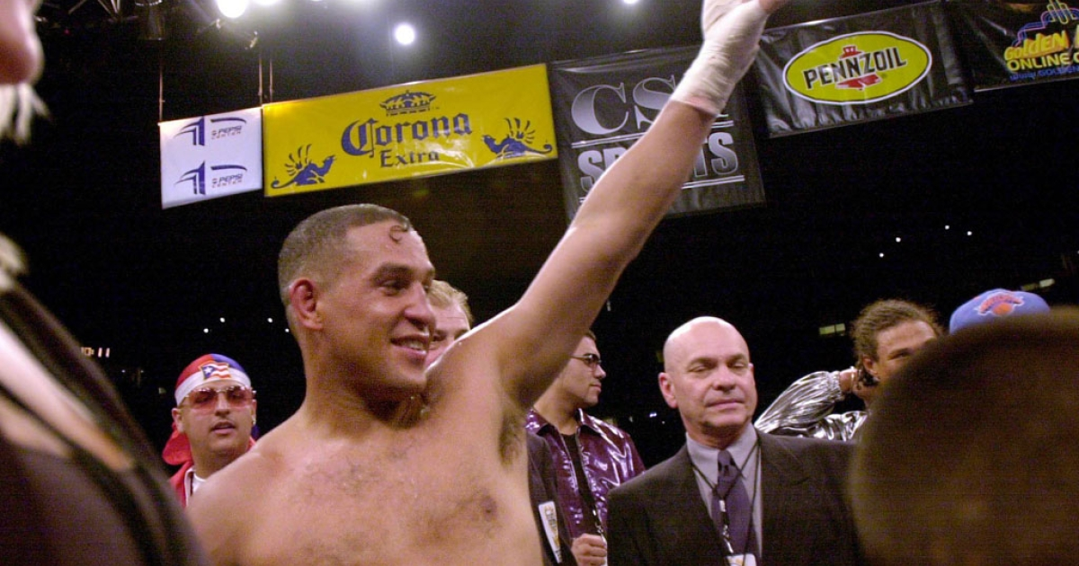 Hector Camacho of Puerto Rico waves to the crowd wearing the NBA super middleweight championship belt after beating Roberto Duran at the Pepsi Center on July 14, 2001 in Denver.</p>