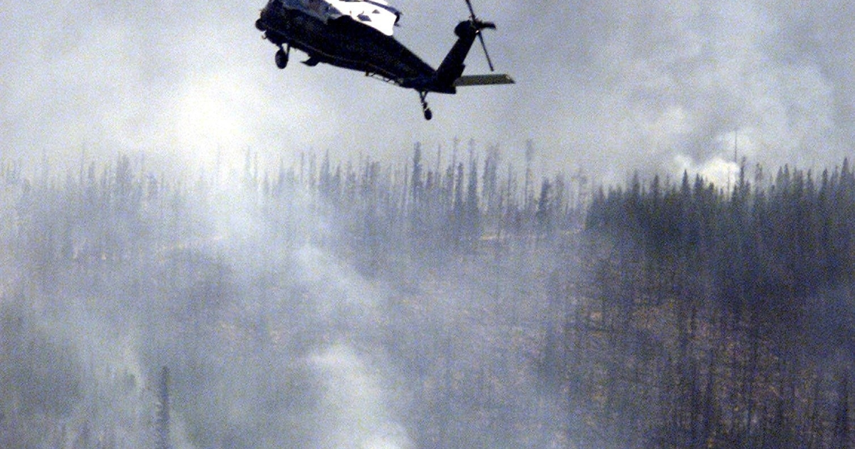 Marine One flying over a fire zone about 30 miles north of McCall, Idaho, on Aug. 8, 2000.</p>