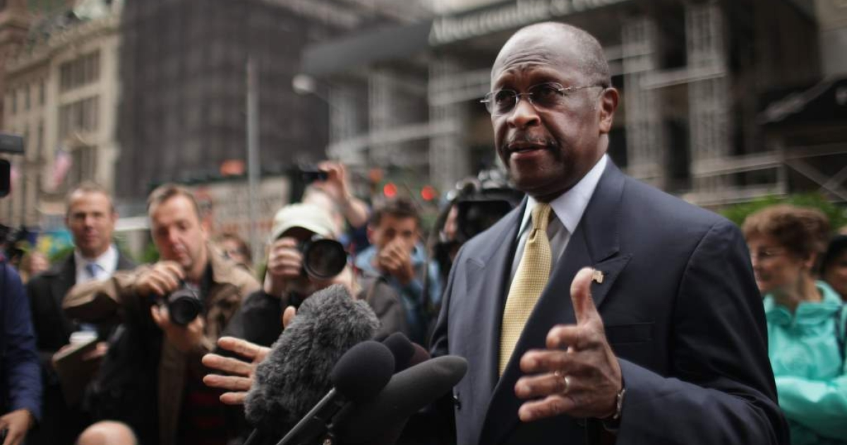 Republican presidential candidate Herman Cain speaks to the media outside of Trump Towers before a scheduled appearance with real estate mogul Donald Trump on October 3, 2011 in New York City.</p>