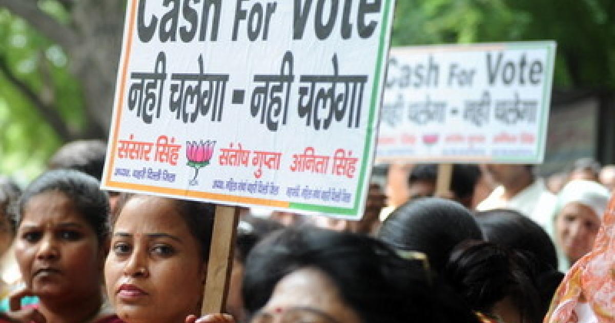 Activists from India's main opposition Bharthiya Janata Party (BJP) hold anti-government placards during a protest against the Cash for Vote Scam in New Delhi on September 3, 2011. The cash-for-votes is a scandal which the United Progressive Alliance (UPA), the majority holding Parliamentary Party Alliance of India led by Prime Minister Manmohan Singh, allegedly bribed Indian MPs to survive a confidence vote on 22 July, 2008.</p>