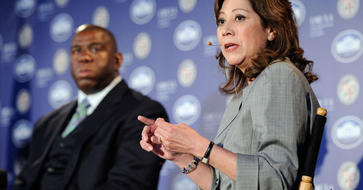 US Labor Secretary Hilda Solis speaks during a Urban Economic Forum co-hosted by White House Business Council and US Small Business Administration at Loyola Marymount University on March 22, 2012 in Los Angeles, California. To her left is LA Lakers legend Magic Johnson.</p>
