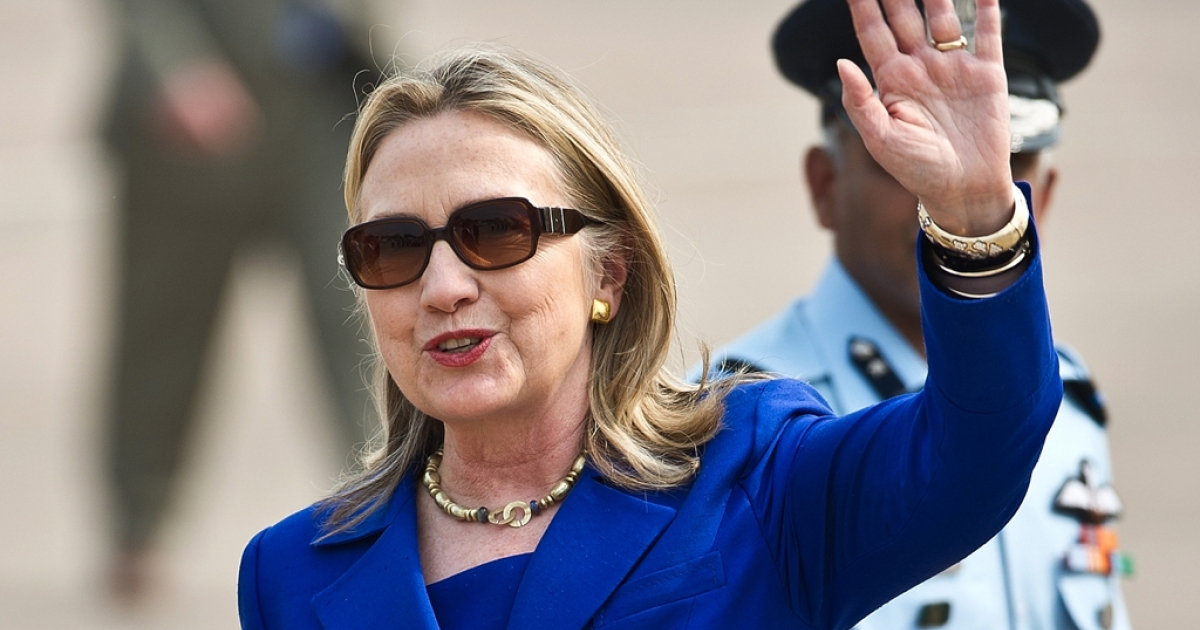 US Secretary of State Hillary Clinton waves on her arrival at Palam Air Force Station in New Delhi on May 7, 2012.</p>