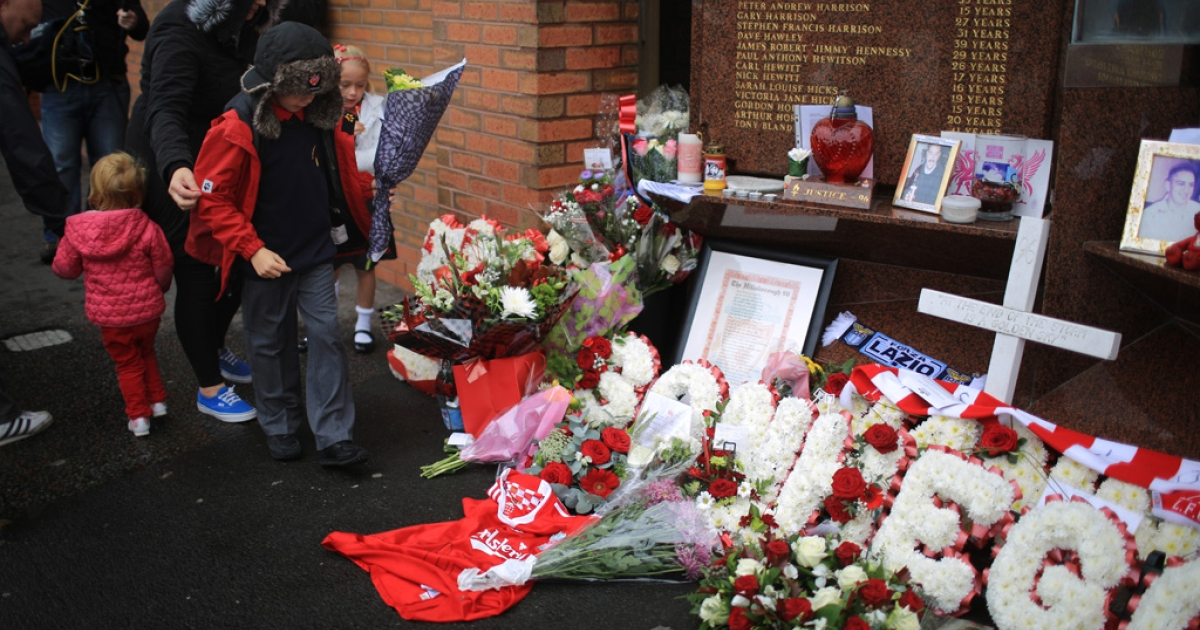 Children lay floral tributes to the victims of the Hillsborough disaster at the Hillsborough memorial at Anfield stadium after the publication of the independent report into the 1989 Hillsborough Disaster on September 12, 2012 in Liverpool, England. Ninety-six fans were crushed to death on overcrowded terraces at Hillsborough football stadium,  Sheffield, during the FA Cup semi-final on April 15 1989.</p>