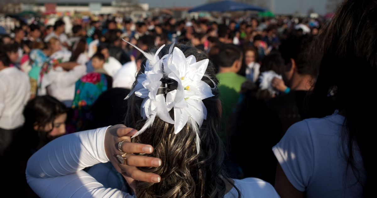 Several thousand Kalaidzhii meet in Mogila, Bulgaria on March 12, 2011. Young marriageable girls dress elaborately to attract the best young men, who traditionally pay between 5,000 and 40,000 Bulgarian Lev ($3,500 to $28,000) for a bride.</p>