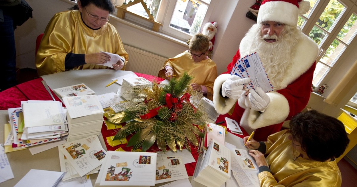 A man dressed as Santa Claus poses with his 'helpers' who are busy answering children's letters in the Santa Claus post office in the Eastern German town of Himmelpfort (Heaven's Gate) on November 10, 2011. Children can send their Christmas wish lists to Himmelpfort from around the world and receive a reply from Santa. In 2010, the post office here received 285.000 letters in 17 languages.</p>