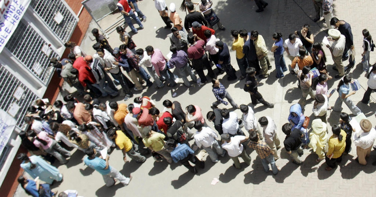 NEW DELHI, INDIA:  An Indian student stand in a queue to get admission forms at the Hindu College in New Delhi, 01 June 2005.  Thousands of students from all over India, who succeeded in their higher secondary examinations, seek admission in the prestigious Delhi University which offers more than 90,000 seats.</p>