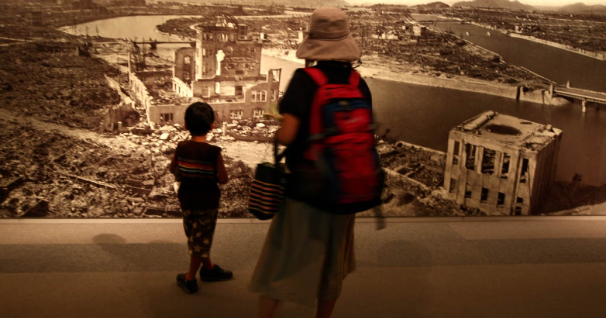 HIROSHIMA, JAPAN - AUGUST 05:  A woman woman and her son look wall picture of Hiroshima Peace Memorial, commonly called the Atomic Bomb Dome at the Hiroshima Peace Memorial Museum on August 5, 2012 in Hiroshima. Japan. Tomorrow marks the 67th anniversary of the first atomic bomb dropped on Hiroshima by the United States on August 6, 1945, killing an estimated 70,000 people instantly with many thousands more dying over the following years from the effects of radiation. Three days later another atomic bomb was dropped on Nagasaki, ending World War II.</p>