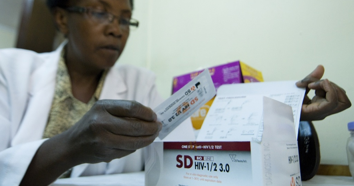 A government medical worker at the National AIDS &amp; STI Control Program, NASCOP, looks on March 29, 2012 at an HIV rapid test kits that was among those recalled by the Kenyan government from its clinics earlier in the year.</p>