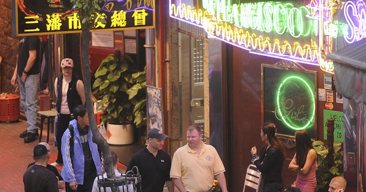 Bars and entertainment establishments in the Wanchai area of Hong Kong prepare for a large influx of sailors during a 2008 visit by US warships.</p>