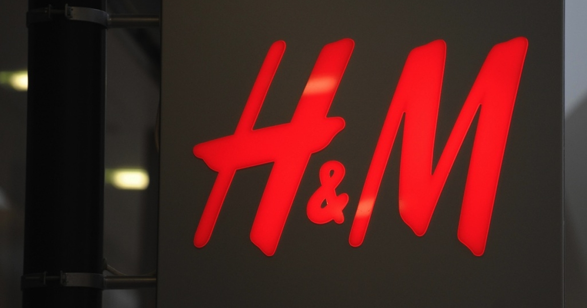 Photo taken on September 30, 2008 of the logo of Swedish high-street clothing chain Hennes &amp; Mauritz (H&amp;M) in Aalborg.</p>