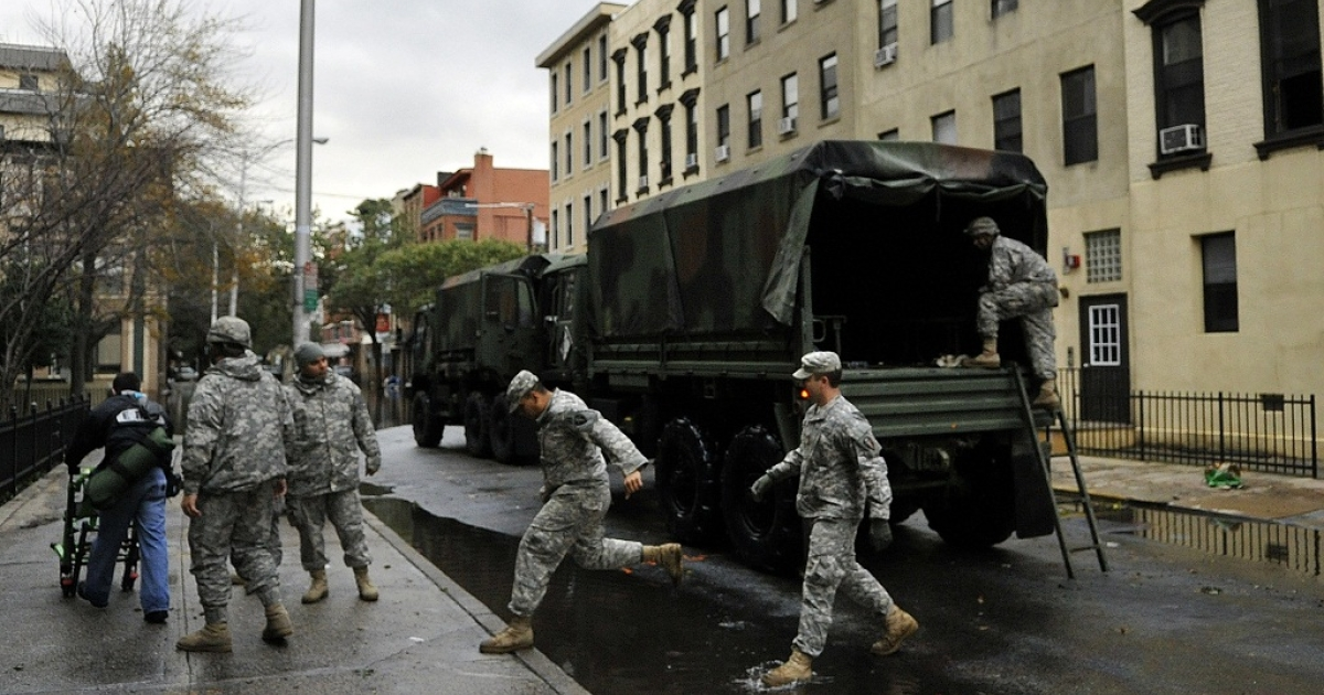 Members of the Army National Guard Unit Gulf 250 from Morristown, NJ prepare to evacuate victims from Hurricane Sandy on October 31, 2012 in Hoboken, New Jersey.</p>