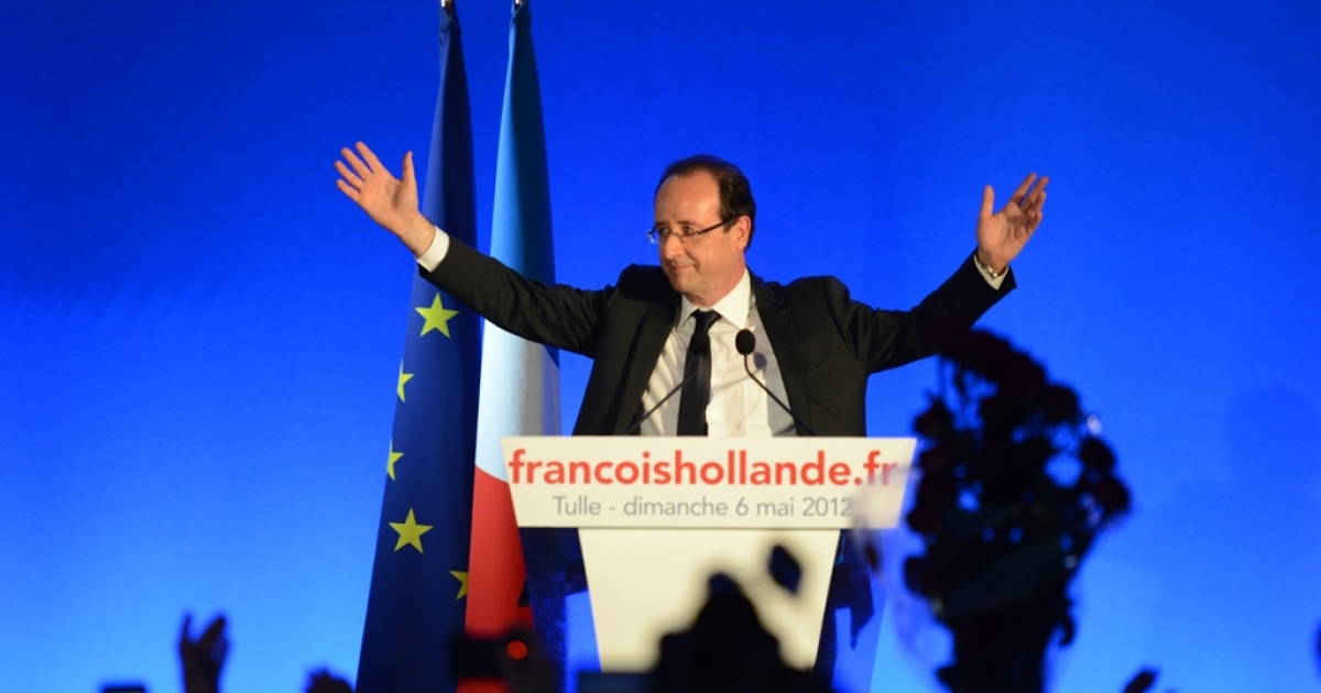 Francois Hollande waves as he arrives on stage to give a victory speech after the results of the second round of the presidential election on May 6, 2012 in Tulle, southwestern France. Hollande was elected France's first Socialist president in nearly two decades today, dealing a humiliating defeat to incumbent Nicolas Sarkozy and shaking up European politics.</p>