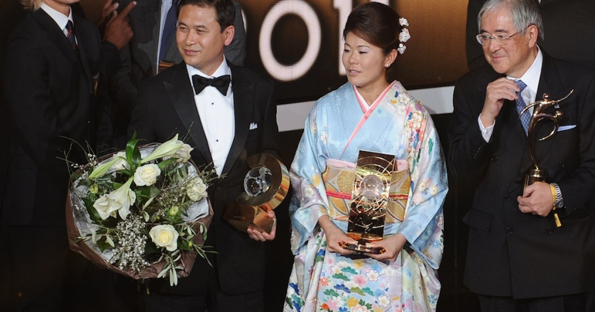Japanese footballer, Homare Sawa (C), the president of the Japanese football association Junji Ogura (R) and Japanese Womens' football team coach Norio Sasaki pose with their awards during the FIFA ballon d'or ceremony on January 9, 2012 at the Kongresshaus in Zurich.</p>