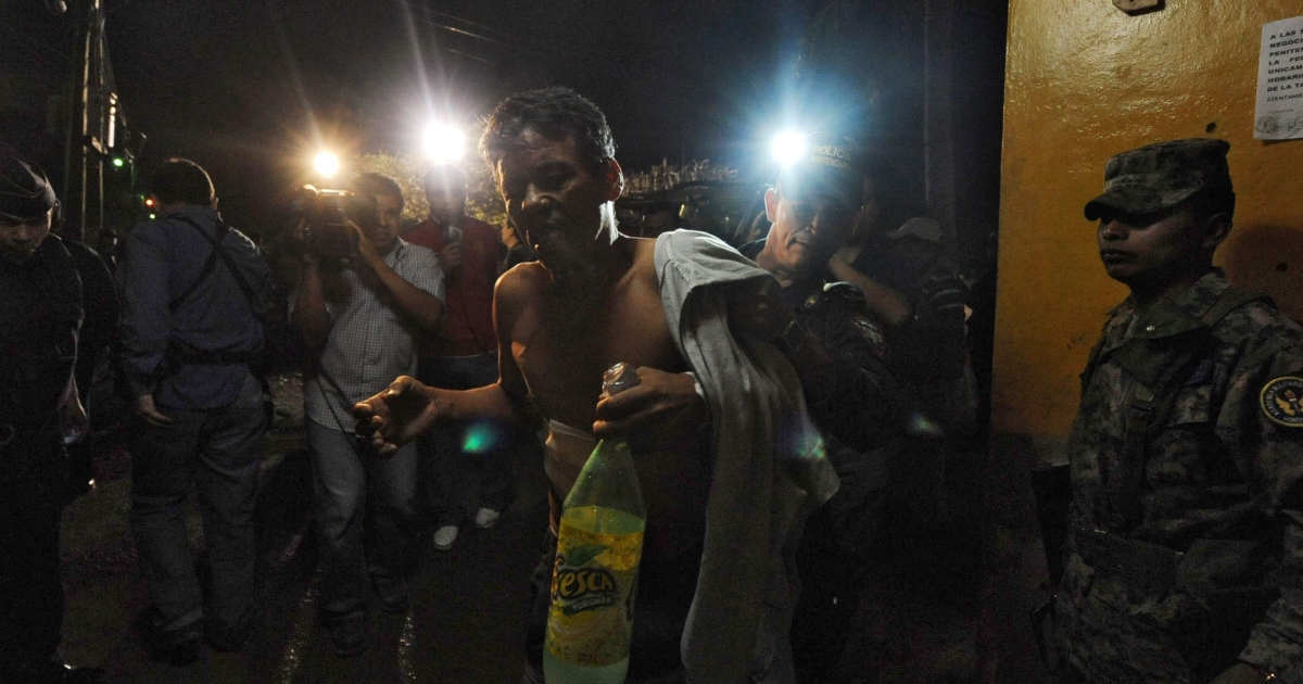 A surviving inmate is evacuated from the jail at Comayagua where at least 350 prisoners were killed and scores injured after a fire tore through the Central Honduras facility.</p>