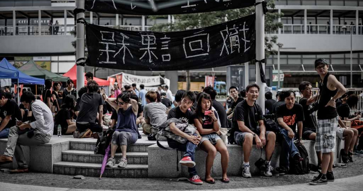 Students sit in front of the Central Government Complex in Hong Kong on Sept. 4, 2012, as students and teachers protested for a sixth straight day against plans to introduce Chinese patriotism classes.</p>