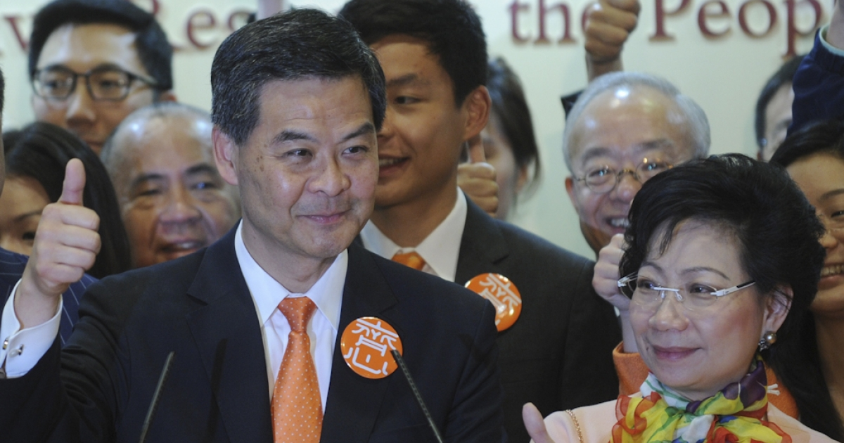 Hong Kong chief executive elect CY Leung and his wife Regina Leung give a thumbs up sign at a press conference after Leung won the Hong Kong chief executive election on March 25, 2012.  Former government adviser and property consultant Leung Chun-ying won Hong Kong's leadership election after the most divisive vote since the city reverted to Chinese rule in 1997.</p>
