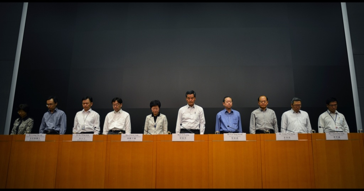 Hong Kong's Chief Executive Leung Chun-ying (C) joins representatives of various government departments as they observe a minute of silence at the start of a press conference in Hong Kong on October 2, 2012 following a deadly ferry collision.</p>