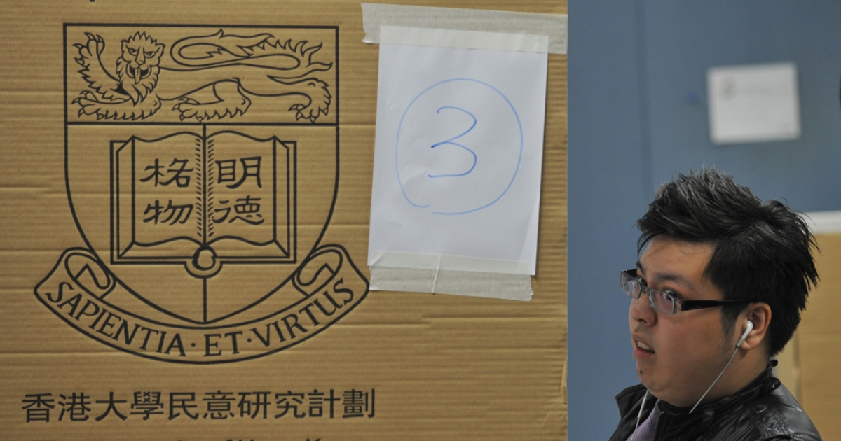 A man reacts at a polling booth at a mock election for Hong Kong's chief executive at the Hong Kong Polytechnic University on March 23, 2012. Thousands of people who do not have the right to vote in the tightly controlled