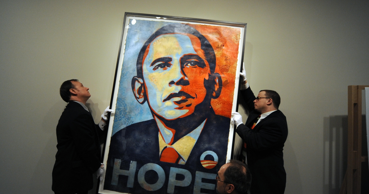 Workers install Shepard Fairey's portrait of Barack Obama at the National Portrait Gallery in Washington on Jan 17, 2009.</p>