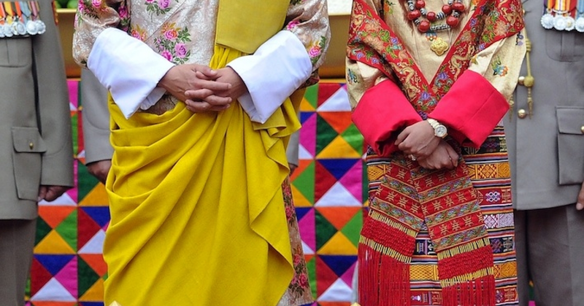 The stunning King of Bhutan Jigme Khesar Namgyel Wangchuck (L) and his beautiful future queen Jetsun Pema (R) stand together during their marriage ceremony in the main courtyard of the 17th-century fortified monastery or dzong in Punakha on October 13, 2011.</p>