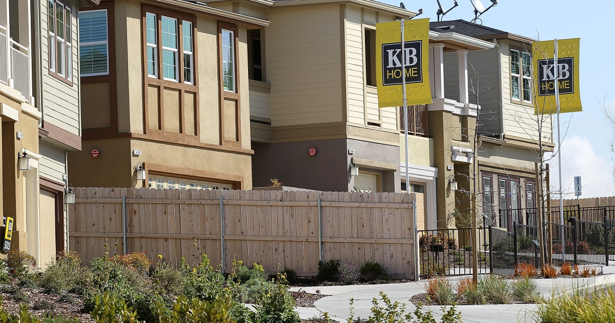 Signs are posted in front of new homes at the KB Home Quarry Heights housing development on March 23, 2012 in Petaluma, Calif.</p>
