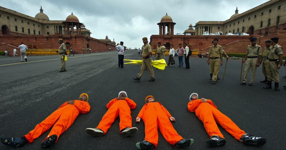 Greenpeace activists dressed as coal miners lie on the ground during a protest  near Parliament in New Delhi on August 21, 2012 against alleged corruption in the allotment of coal mining blocks. A recent survey revealed that most Indians think corruption is the biggest problem facing the country, but it's not an election issue because they also think all parties are equally corrupt.</p>