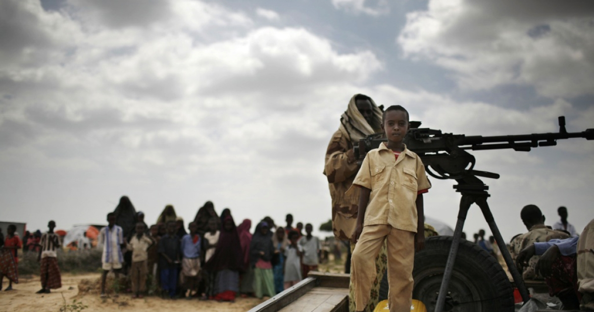 A boy stands on a vehicle with Somali soldiers in Daymarudi Camp Dec. 10 2007 on the outskirts of Mogadishu.</p>