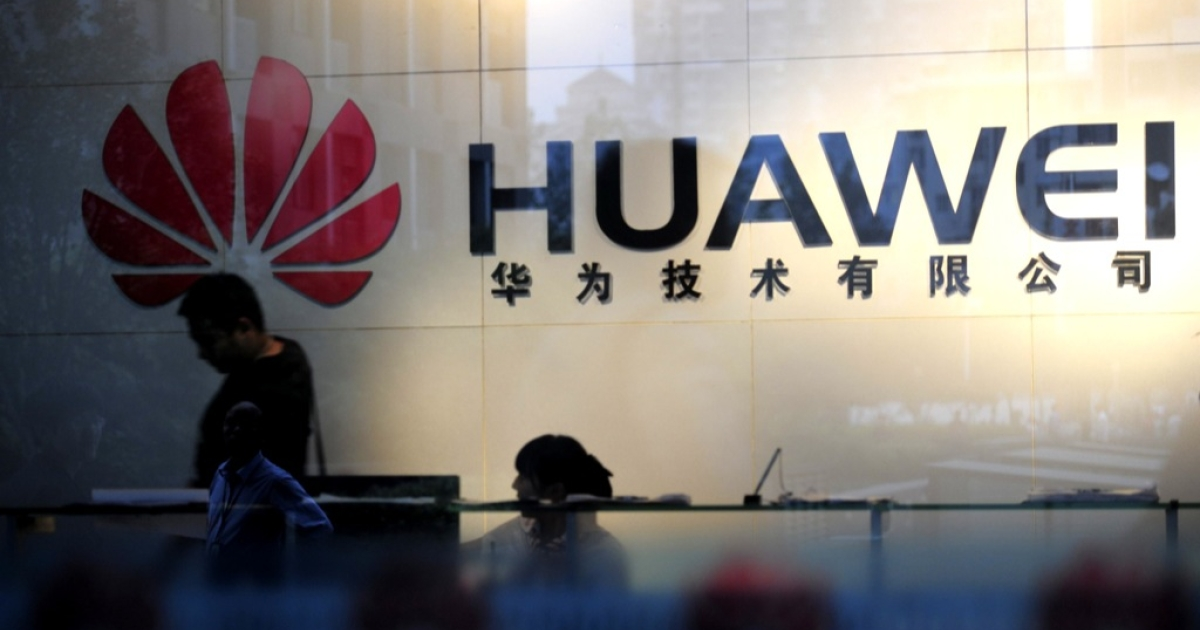 Staff and visitors walk pass the lobby at the Huawei office in Wuhan, central China's Hubei province on October 8, 2012. Beijing on October 8 urged Washington to 'set aside prejudices' after a draft Congressional report said Chinese telecom firms Huawei and ZTE were security threats that should be banned from business in the US.</p>