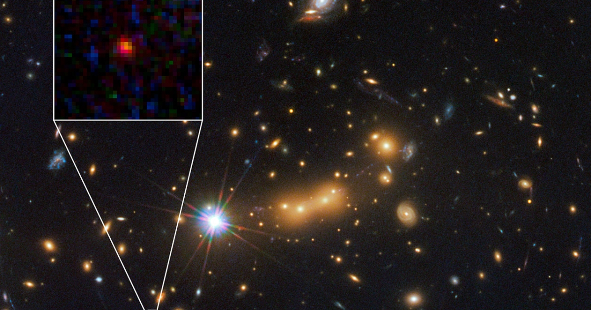 In this image, astronomers use the NASA/ESA Hubble Space Telescope and a cosmic zoom lens to uncover the farthest known galaxy in the Universe. The newly discovered galaxy, named MACS0647-JD, is very young and only a tiny fraction of the size of our Milky Way. The object is observed 420 million years after the Big Bang, when the Universe was 3 percent of its present age of 13.7 billion years.</p>