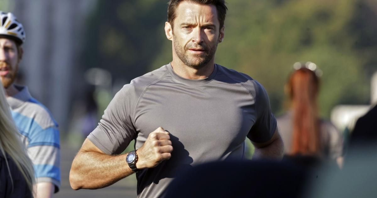 Australian movie star Hugh Jackman runs through Budapest on Sept. 2, 2011, during a commercial film shooting.</p>