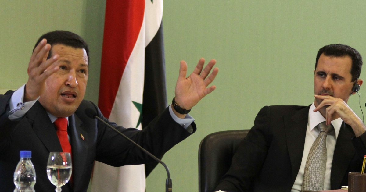 Friends till the end: Venezuelan President Hugo Chavez and his Syrian counterpart Bashar al-Assad in the al-Shaab presidential palace in Damascus in 2010.</p>