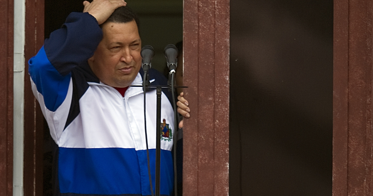 Venezuelan President Hugo Chávez greets supporters from the Miraflores presidential palace in Caracas on April 13.</p>