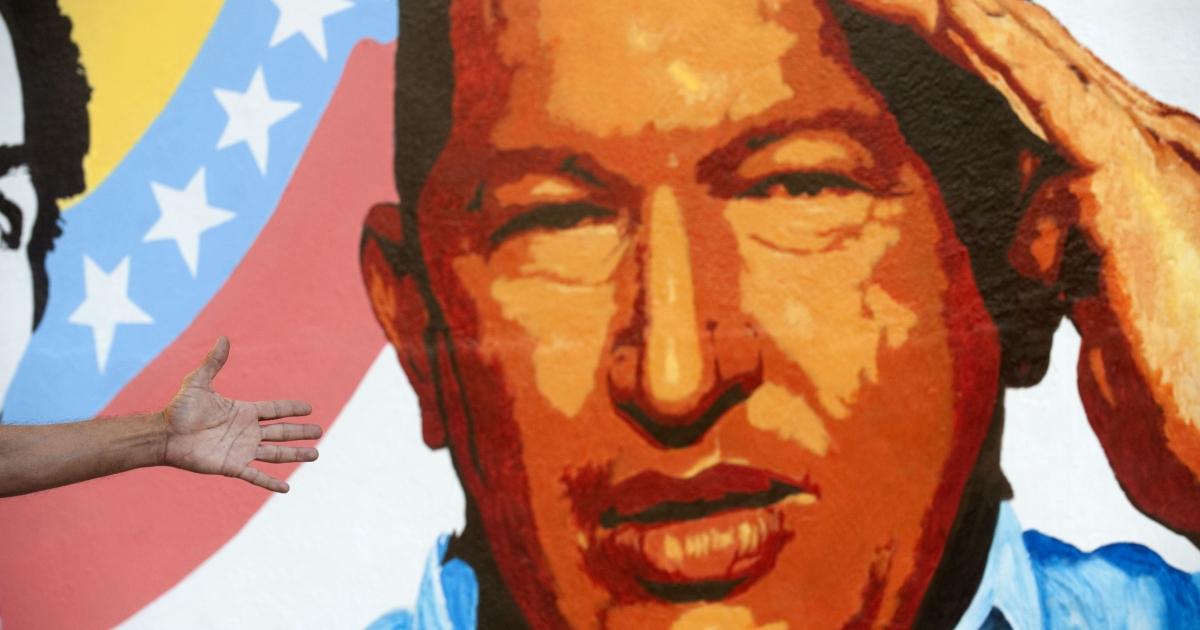 A mural of Venezuelan President Hugo Chavez in Caracas.</p>