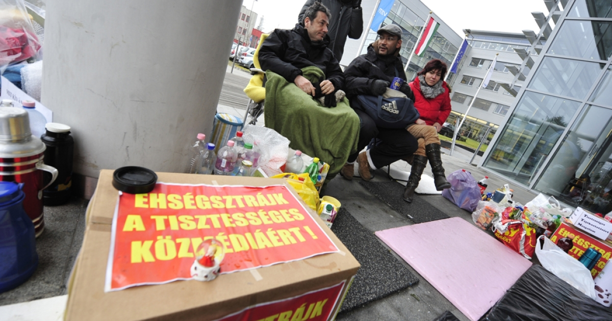 Four Hungarian journalists of the state public television protest in front of the headquarters of Hungarian Television Foundation in Budapest during their hunger strike against the news manipulation of MTVA. Sign on the box reads
