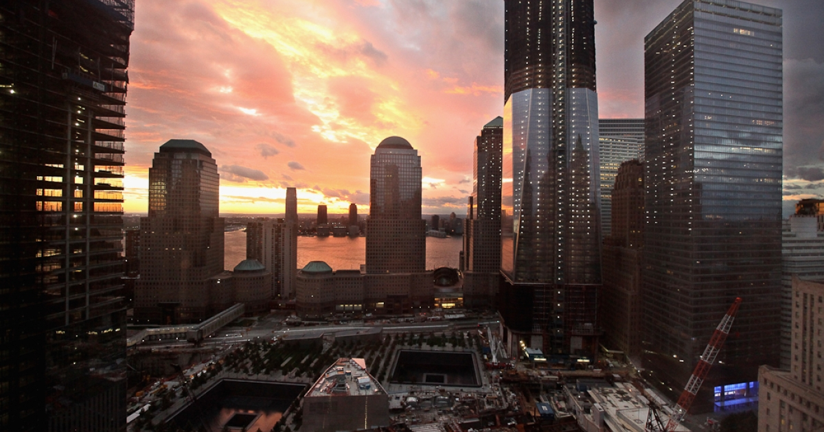 The sun sets over Jersey City and the World Trade Center site, with One World Trade Center to the right on August 28, 2011 in New York City.</p>