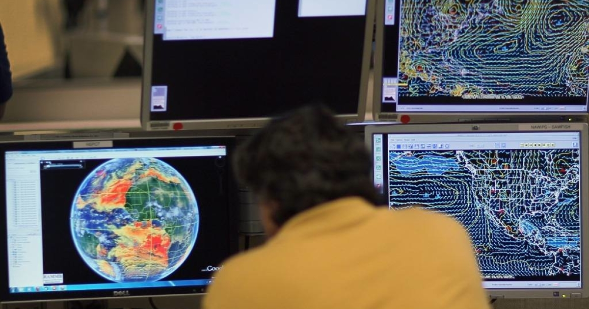 Senior hurricane forecaster Dr. Jack Beven studies computer models as he tracks approaching tropical storms.</p>